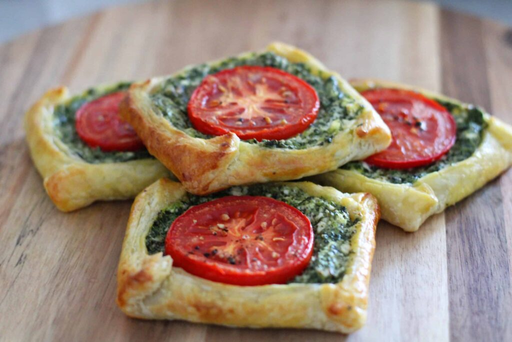 spinach and feta galette with full pastry crust in rectangular shapes