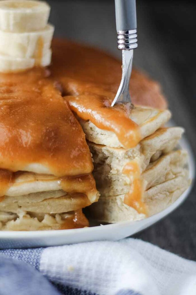 banana pancake stack with peanut butter syrup
