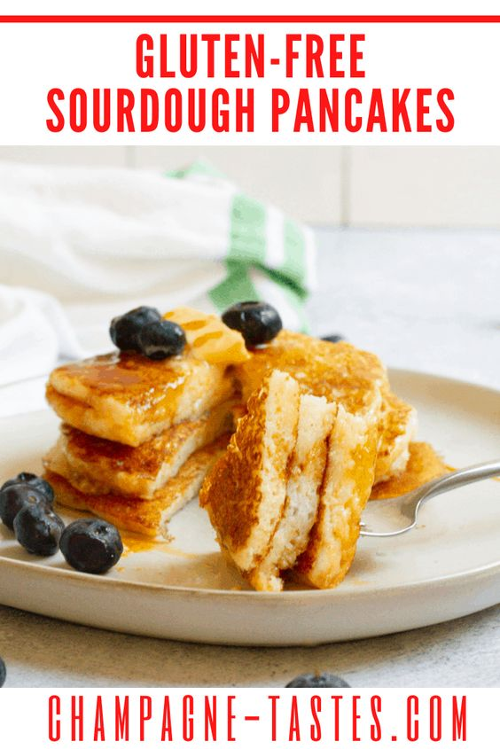 creative pancake recipes - gluten free sourdough pancake stack with a big bite on fork
