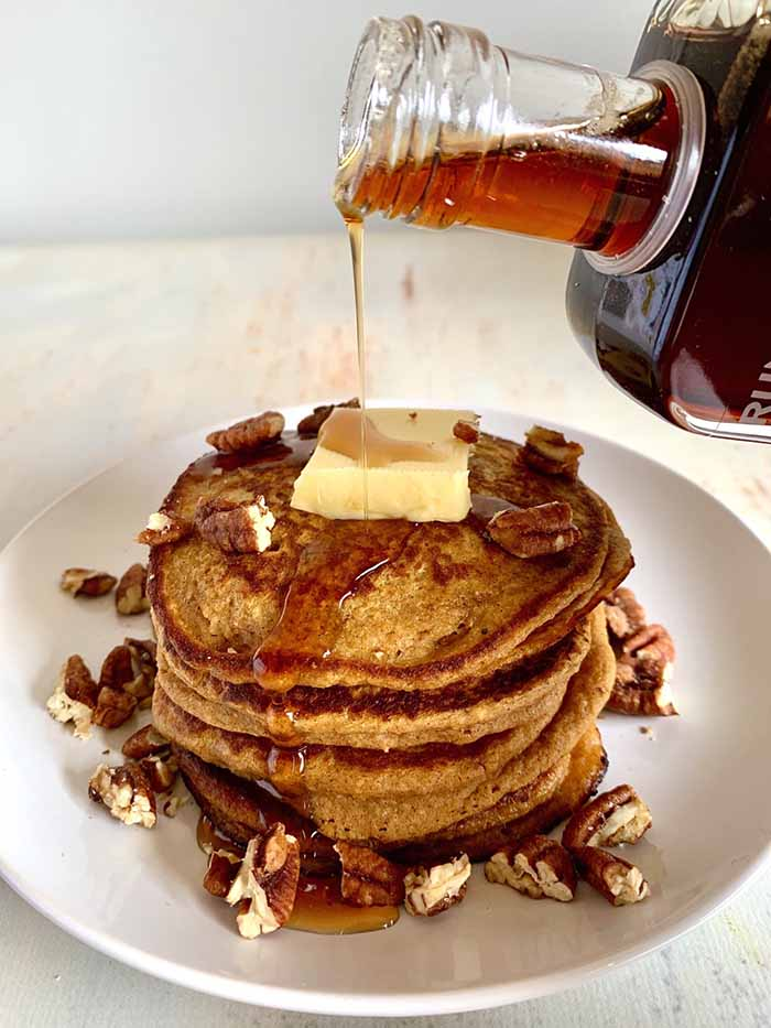 sweet potato oatmeal pancake with butter and drizzled maple syrup
