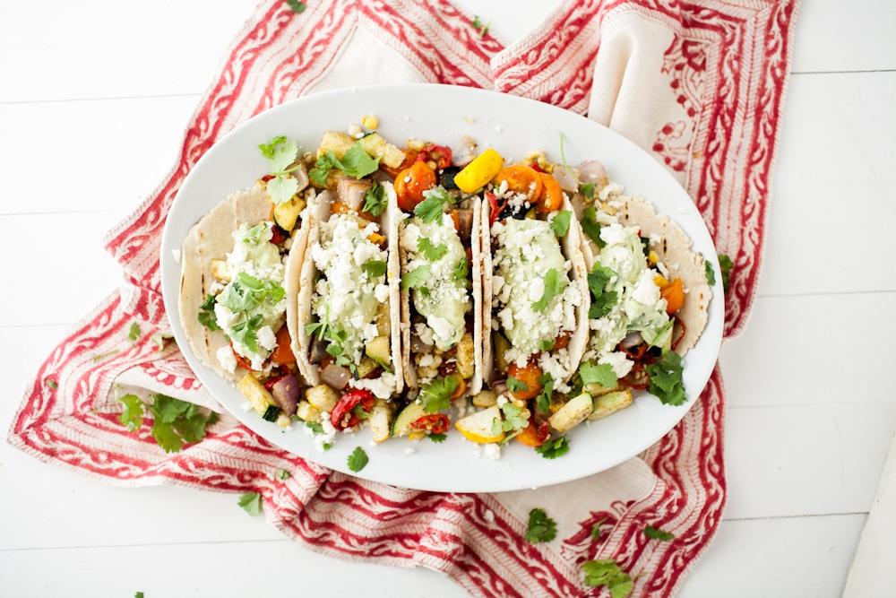 roasted veggie tacos with avocado cream and feta