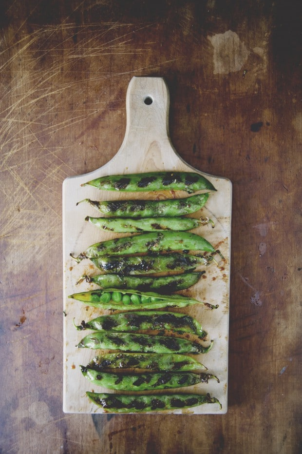 spicy grilled pea pods with chili soy glaze and mint