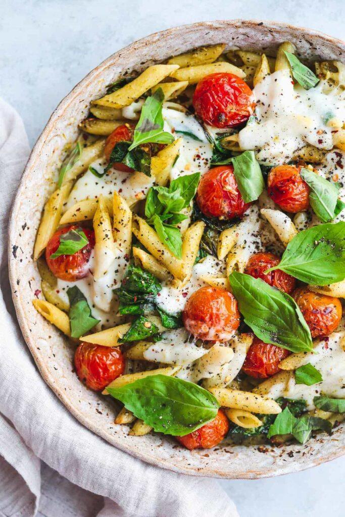 baked pasta with melted mozzarella cheese tomato and mozzarella