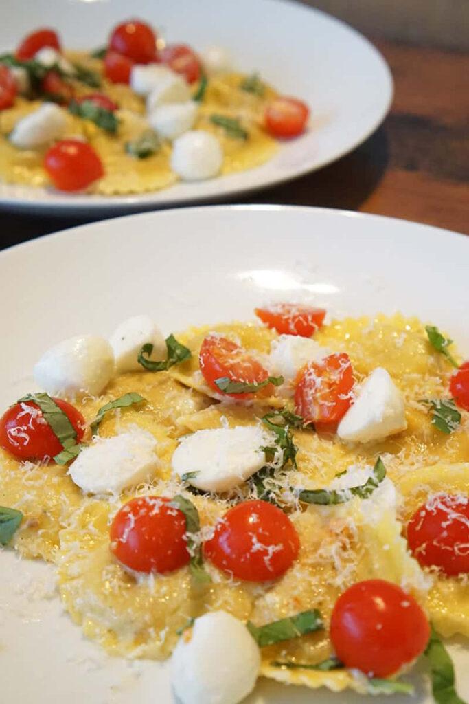ravioli with mozzarella tomato and basil plus parmesan cheese