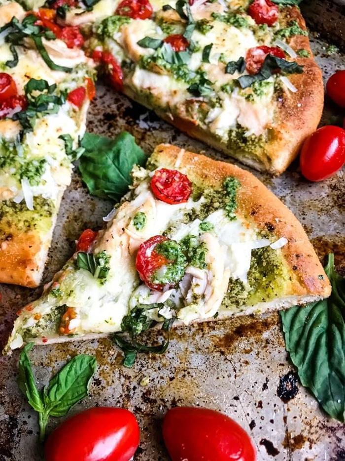 pizza with mozzarella tomato and pesto