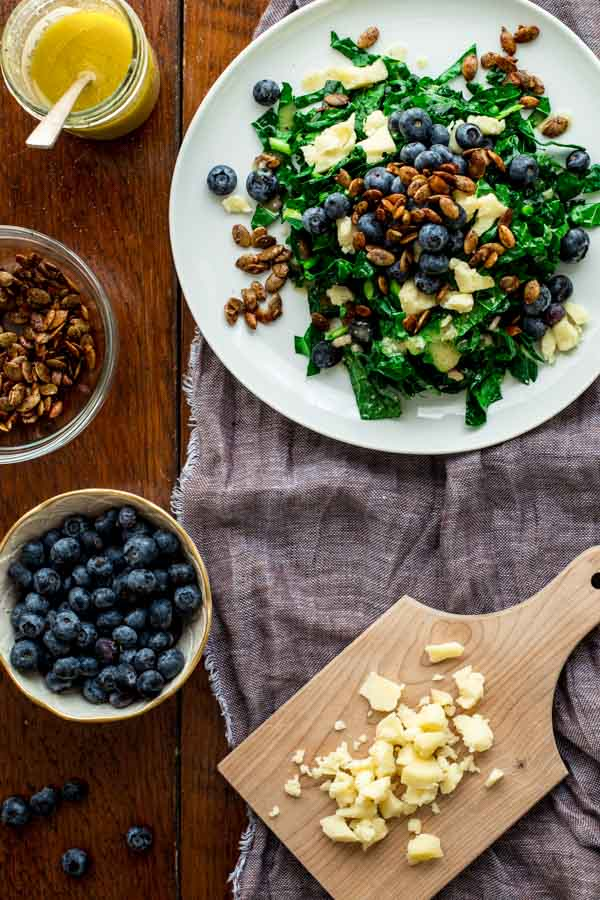 Healthy Spring Recipes Meal Plan from Healthy Seasonal Recipes- kale salad with blueberries manchego pumpkin seed clusters