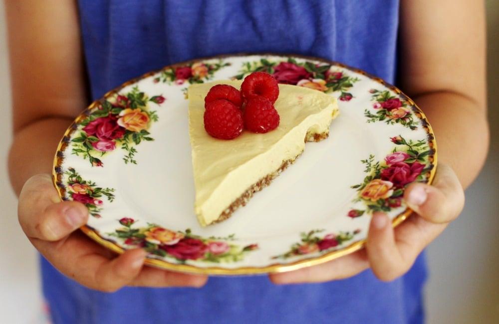 No-Bake Raw Vegan Mango Raspberry Cheesecake Recipe on flower plate