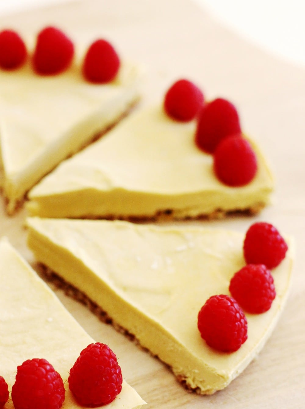 No-Bake Raw Vegan Mango Raspberry Cheesecake Recipe slices