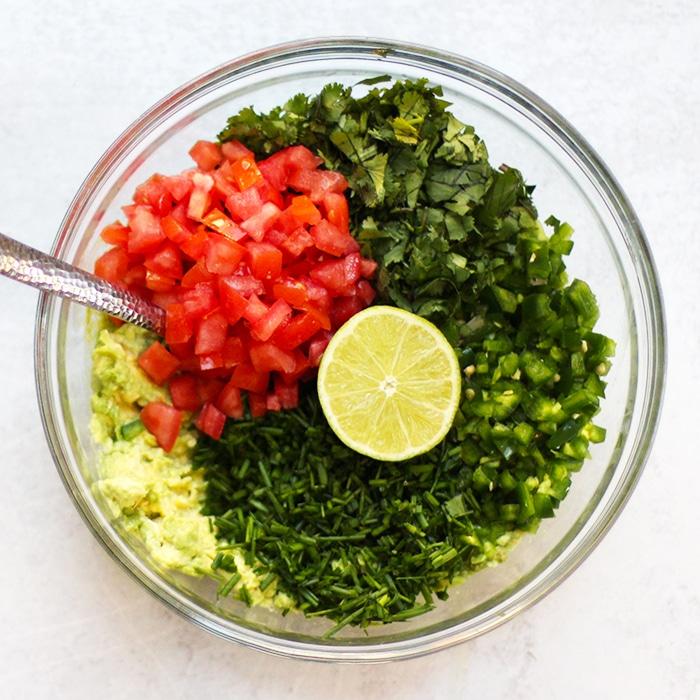 cilantro guacamole recipe ingredients in a bowl