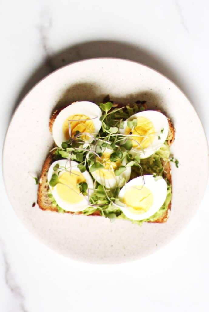 Avocado egg toast recipe with micro greens