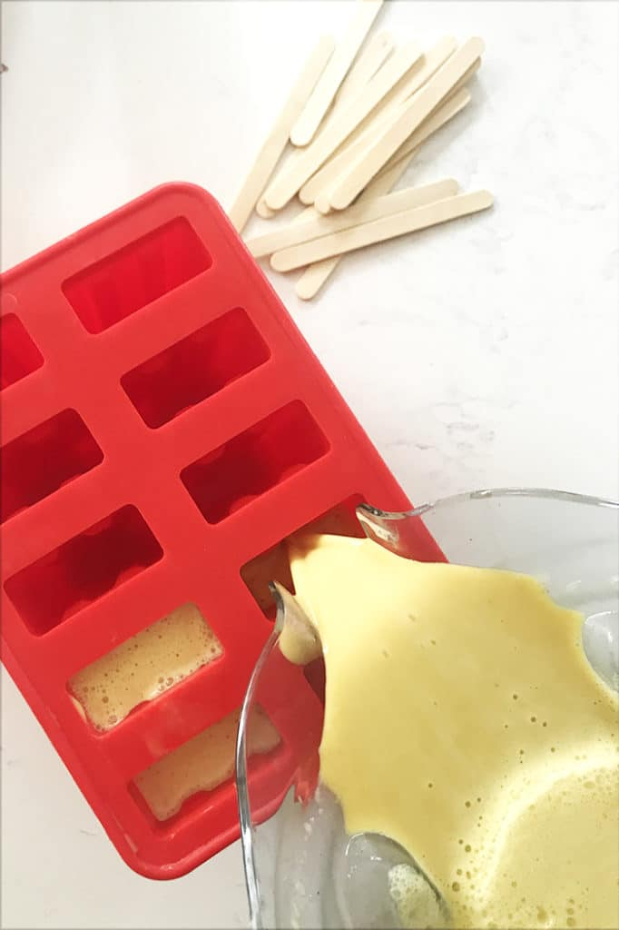 pouring the golden milk coconut popsicle recipe